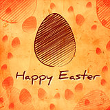 Happy Easter and brown egg over orange old paper background