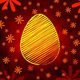 yellow easter egg over brown old paper background with flowers