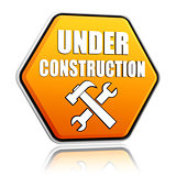 under construction and tools sign yellow hexagon banner