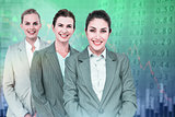 Composite image of smiling young businesswomen in a line