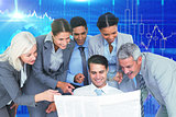Composite image of happy business people looking at newspaper