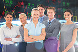 Composite image of business team smiling at camera