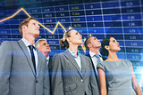 Composite image of business team looking up