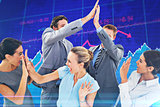 Composite image of excited business team cheering