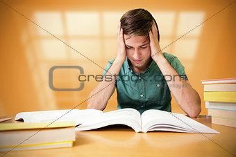Composite image of student sitting in library reading