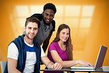 Composite image of creative team using laptop