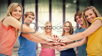 Composite image of low angle shot of friends smiling and looking at the camera