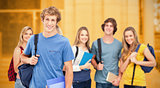 Composite image of a group of smiling college students look into the camera as one man stands in fro