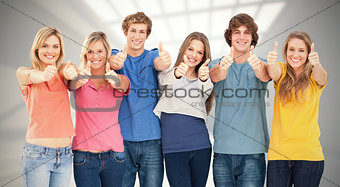 Composite image of six friends giving thumbs up as they smile