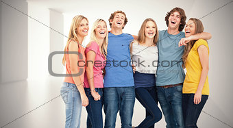 Composite image of full length of a group laughing together and looking at the camera