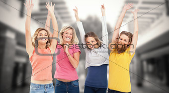 Composite image of smiling celebrating girls jumping up