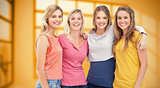 Composite image of four friends standing beside each other and smiling