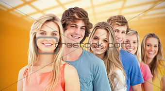 Composite image of a smiling group standing behind each other
