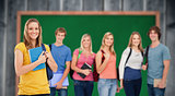 Composite image of a group of college students standing as one girl stands in front of them