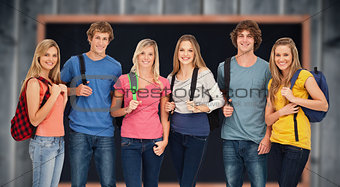 Composite image of smiling group with backpacks on as they smile