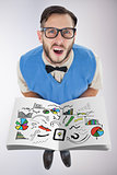 Composite image of nerd showing a book