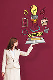 Composite image of businesswoman showing a book