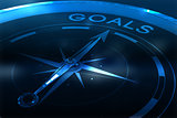 Composite image of compass pointing to goals