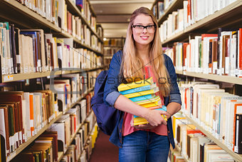 Composite image of pretty student in the library