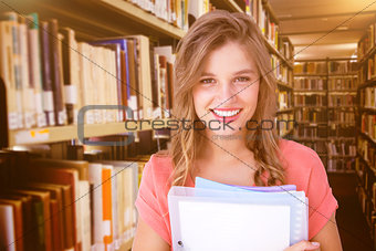 Composite image of smiling hipster holding notebook