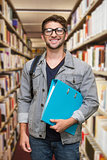 Composite image of student smiling at camera in library