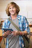 Composite image of student using tablet in library