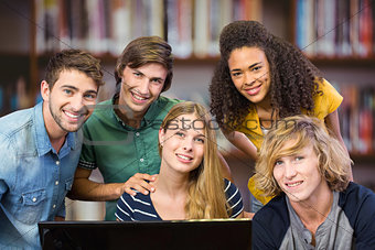Composite image of college students using computer