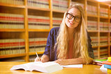 Composite image of student studying in the library