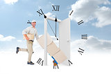 Composite image of happy delivery man with trolley of boxes running on white background