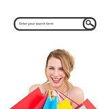 Composite image of portrait of a smiling woman with shopping bags