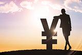 Composite image of silhouette beside yen symbol