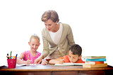 Composite image of teacher helping pupils in library