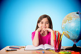 Composite image of cute pupil working at her desk