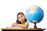 Composite image of cute pupils sitting at desk