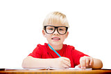 Composite image of cute pupil at desk