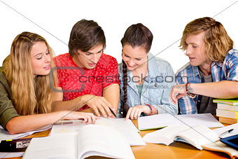 College students doing homework in library