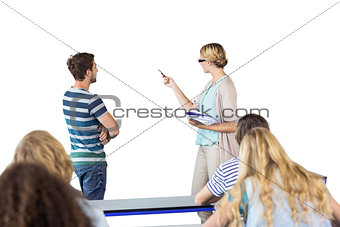 Composite image of student and teacher pointing at blackboard in class