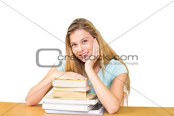 Composite image of portrait of female student in library