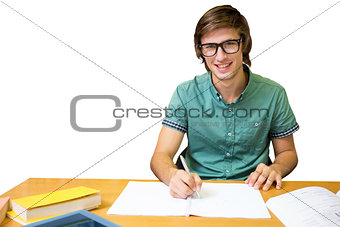 Composite image of student sitting in library writing