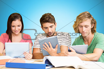 Composite image of college students using digital tablets in library