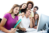 Composite image of smiling students in computer class