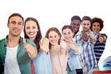 Composite image of fashion students showing thumbs up