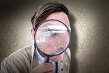 Composite image of spy looking through magnifier
