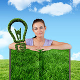 Composite image of woman with lawn book
