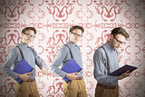 Composite image of nerd with notebook