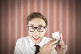 Composite image of geeky businessman using a calculator