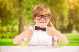 Composite image of cute pupil showing thumbs up