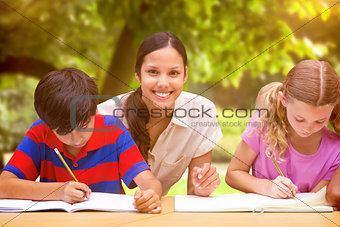 Composite image of pretty teacher helping pupils in library