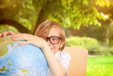Composite image of cute pupil holding globe