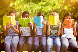 Composite image of children reading books at park
